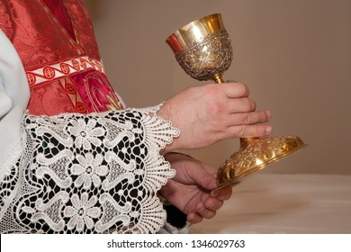 hands of priest by the mass and the cap