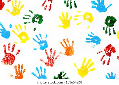 Hands prints made by children isolated on white background