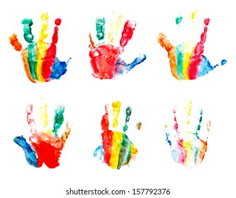 Hands prints made by children isolated on white background.