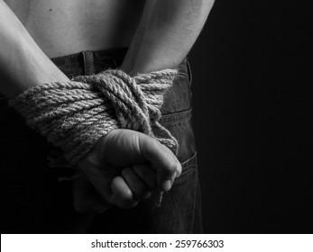 hands of the prisoner. black and white