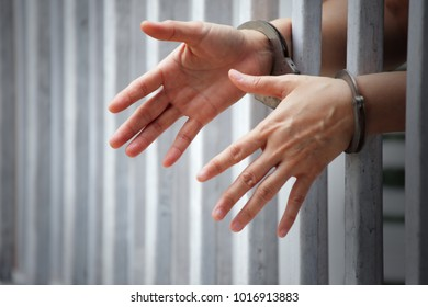 hands of prisoner in jail locked with handcuff
