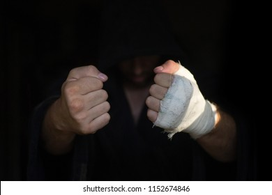 Hands of Pro boxer with bandage on the fists before fight. Professional fighter is prepared in the locker room before fight, selected focus.