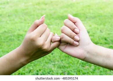 hands promises together