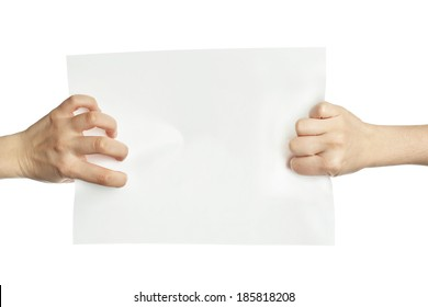 Hands pulling blank paper