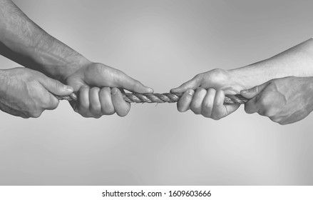 Hands pulling rope playing tug of war concept