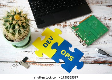 hands put on board words Dev and Ops. DevOps Concept for software engineering culture and practice of software development and operation, closeup - Shutterstock ID 1950535597