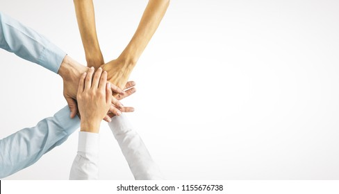 Hands put together on white background with copy space. Union, togetherness and teamwork concept