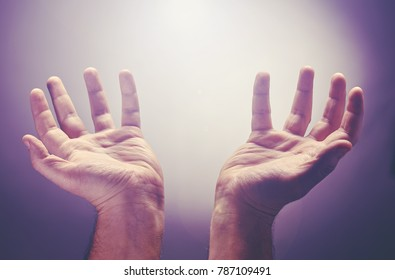 Hands raise with the palm opened up, worship or pray for good things under the light ray from heaven. Worship is an act of religious devotion usually directed towards a deity, god, angel
