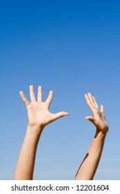 hands raised to sky,