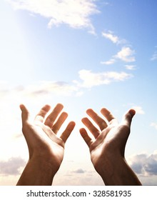 hands reach for sky, close up