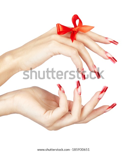Hands with red french acrylic nails manicure and painting with bow on finger isolated  white background