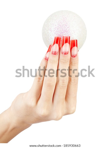 Hands with red french false acrylic nails manicure holding christmas ball isolated on white background