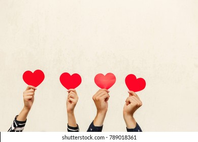 Hands with red hearts. Couple in love. Valentines day concept. Red heart - symbol of love