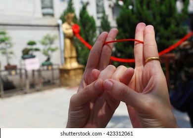 hands and red string,Wong Tai Sin Temple, HONG KONG, CHINA