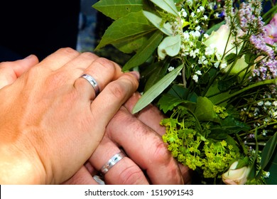 hands with rings on wedding
