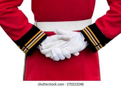 hands of a royal guard wearing white gloves