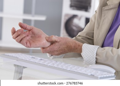 Hands with RSI syndrome over the keyboard of laptop computer