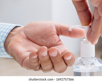 Hands and Sanitizer close up disinfecting hands