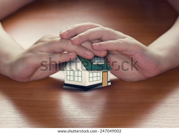 Hands Saving Small House Conceptual Image Stock Photo Edit Now