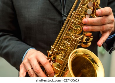 Hands of saxophone player