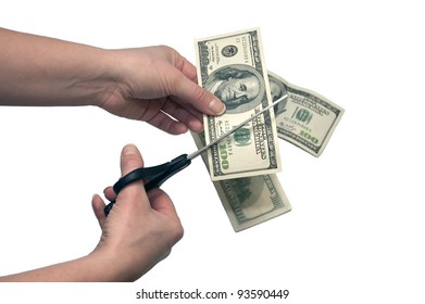 Hands with scissors cutting money isolated on white