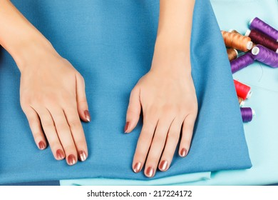 hands of a seamstress at work