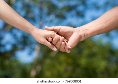 Hands of senior man and his adult daughter