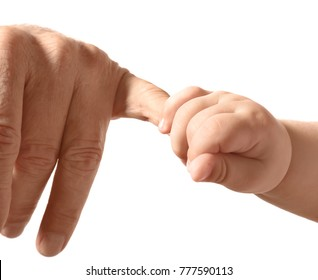 Hands of senior man and little baby on white background