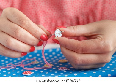 Hands sewing on table