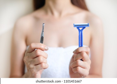 Hands are shaved, armpits or plucking the armpits by using a razor or tweezers, Depilation and skin care concept.
