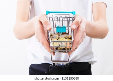hands with shopping cart and coins
