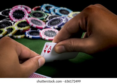 The Hands show chance of winning blackjack game and a pile of chips on the table at casino