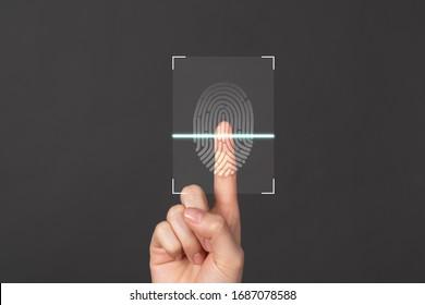 Hands show the fingerprint scanner screen to access personal user online.