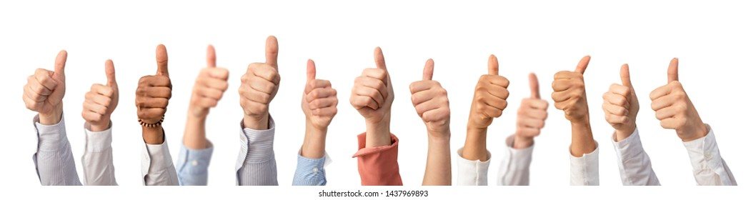 Hands showing the thumb and the symbol ok. Concept of winning people, winners.