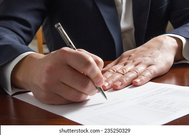 Hands signing business documents