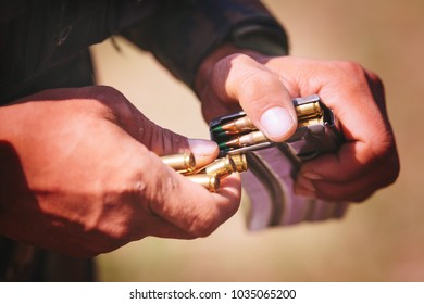 Hands of soldier holding ammunition,military and teamwork concept.