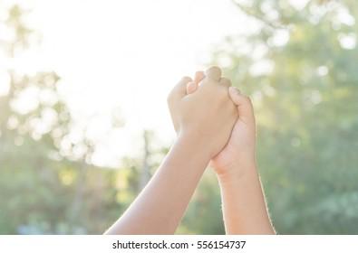 hands Sporting local children on playground