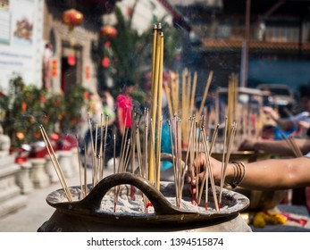 Hand with Incense Stick Images, Stock Photos & Vectors