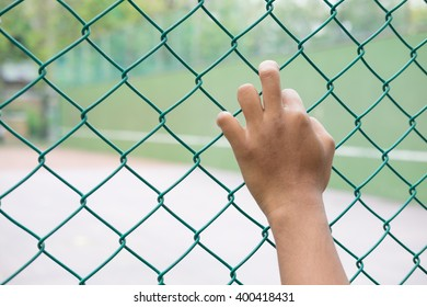 Hands with steel mesh fence , freedom / Independence / hope concept.