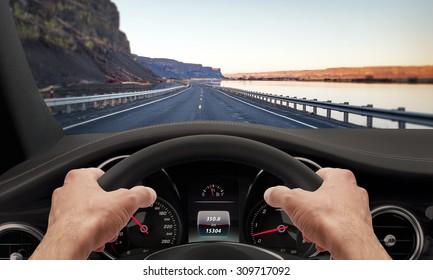Hands steering wheel. Highway car driving.