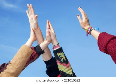 Hands stretch in the height - Shutterstock ID 221010622