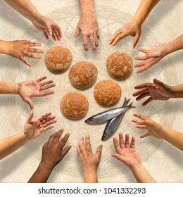 Hands stretching around five small barley loaves and two small fish