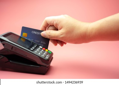 Hands swiping Credit card on Credit card machine or Credit card Terminal, Finance concept.