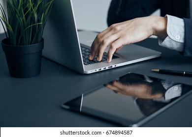 Hands, tablet, business, computer, office, work, desk, documents, phone, laptop.