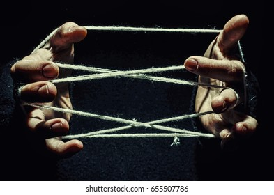 hands are tangled in the thread