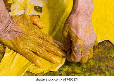 The hands of the Tanner working on the dyeing process at the tannery Ain Azliten. Fes, Morocco