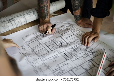 Construction team blueprint on site stock photo 674964133 shutterstock hands with tattoo working on a blueprint malvernweather Image collections