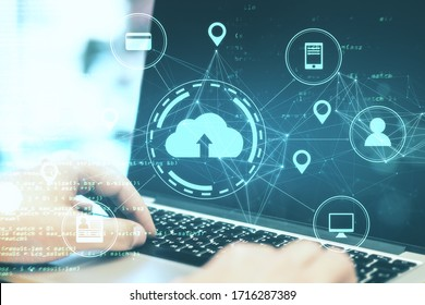 Hands tayping on laptop with online shopping  diagram. Cloud computing and communication concept. Double exposure