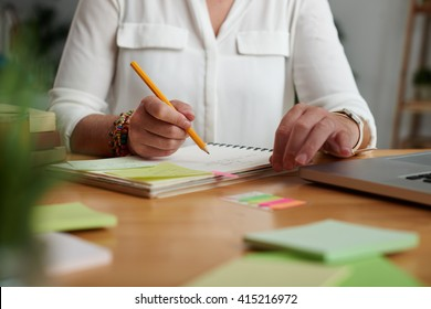 Hands of teacher or business lady working on new project