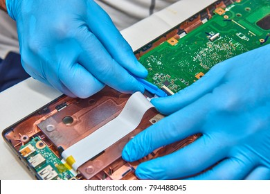 Hands of the technician repairing a computer, Professional laptop repair,Close up with selective focus